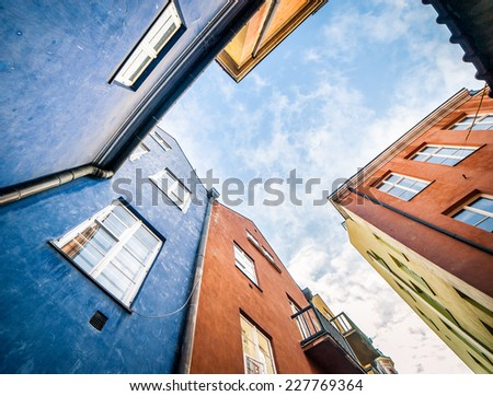 bottom view colorful houses in the center of Warsaw, near the Castle Square, Poland - stock photo