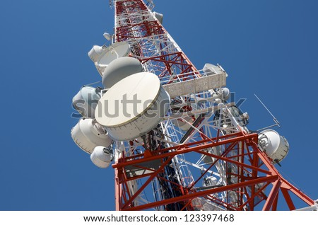 bottom view of  a telecommunications tower with a clear blue sky - stock photo