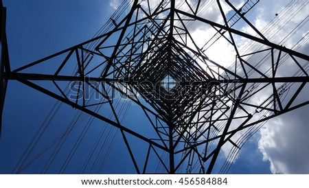 Bottom view of electric pole with beautiful blue sky. - stock photo