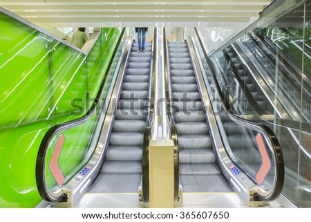Bottom view of escalators, green color combination. panoramic angle of escalator detail. - stock photo