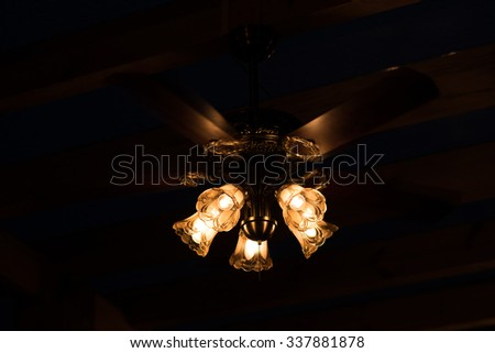 bottom view of illuminated chandelier - stock photo