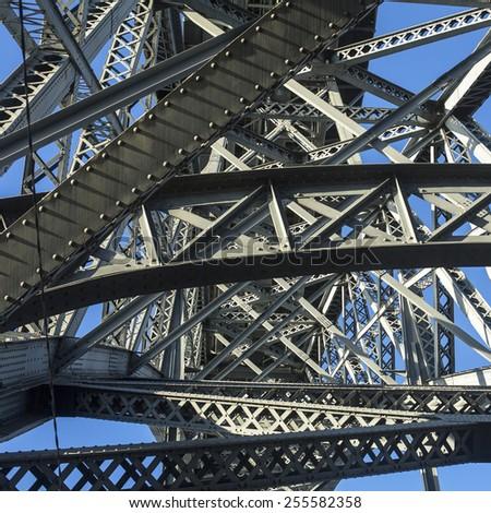 Bottom view of metalworks famous Dom Luis I Bridge in Porto, Portugal. - stock photo