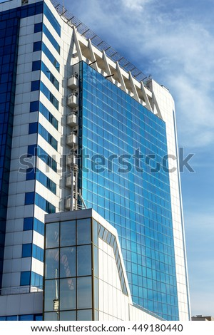 Bottom view of modern high rise office building in the port of Odessa in the sunset at the end of the day - stock photo