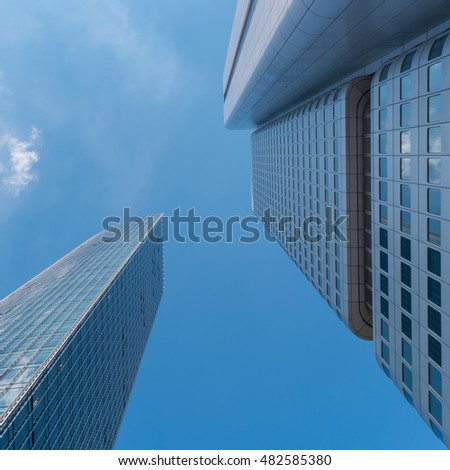 Bottom view of  skyscrapers raising to the sky