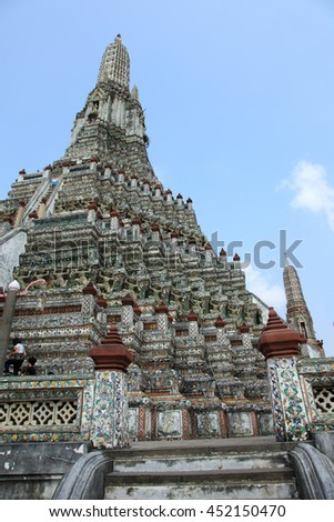 Bottom view of the big tower of the Wat Arun temple in Bangkok - stock photo
