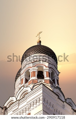Bottom view of the dome of Alexander Nevsky Cathedral in Tallinn, Estonia, on sunrise or sunset background. - stock photo