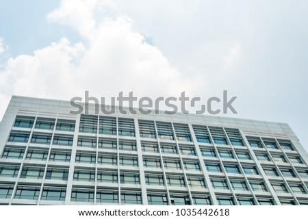 Bottom view of White Old Building with sky background