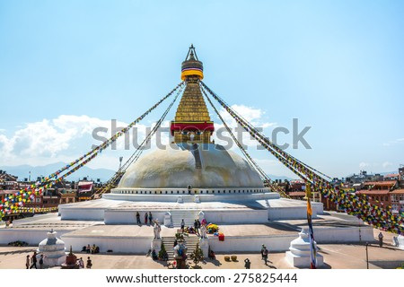 Boudhanath stupa in Kathmandu with buddha eyes and prayer flags. - stock photo