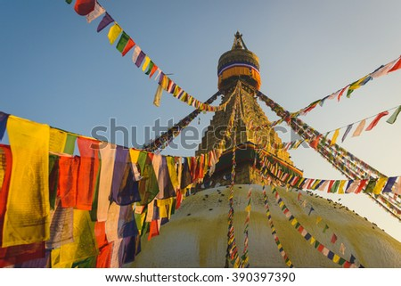 Boudhanath Stupa with hundreds of Pigeons and Prayer flags in Kathmandu, Nepal