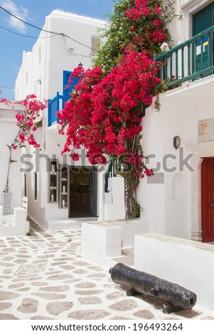 Bougainvillea flowers around a house with a balcony. Mykonos. - stock photo