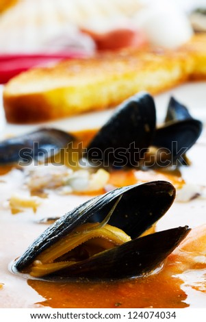 Bouillabaise, fish soup - traditional French fish soup with mussels and shrimp - stock photo