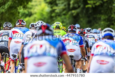 BOUILLE-MENARD,FRANCE- JUL 4:Rear image of the peloton riding during the stage 3 of Tour de France in Bouille-Menard on July 4, 2016.