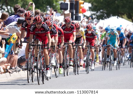 BOULDER, CO - AUGUST 25, 2012:  Team BMC leads the race through the streets of Boulder in the 2012 USA Pro Cycling Challenge on August 25, 2012 in Boulder, CO - stock photo