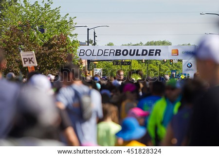 BOULDER, CO - May 25th, 2015: Participants race across the start line of the Bolder Boulder 10K race in Boulder, Co. The race is the largest timed race in the country with over 54,000 participants.