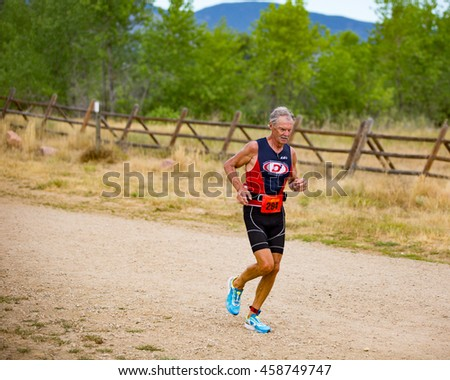 Boulder, Colorado, USA - July 24, 2016: Simon Butterworth runs along the trails at Boulder Reservoir during Tri Boulder.