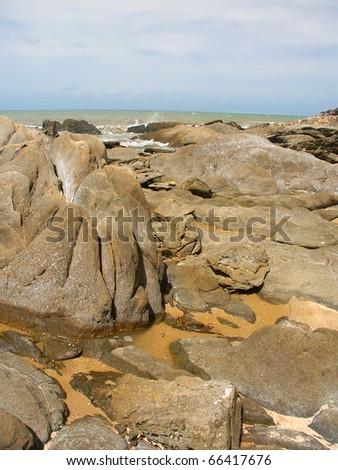 Boulders dot the coast near Trinity Beach of Cairns, Queensland - Australia - stock photo
