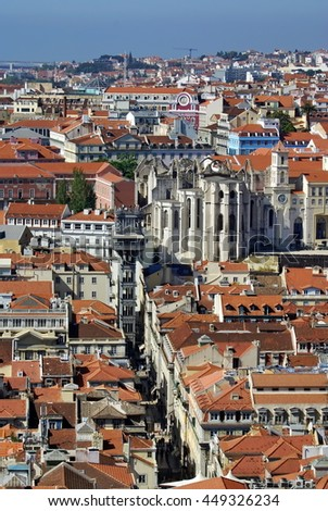 Boulevard running through Lisbon, Portugal, ending at the ruins of the Carmo Monastery
