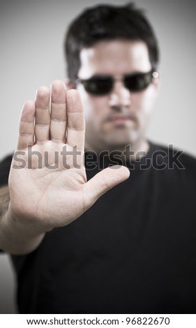 Bouncer makes Stop gesture - stock photo