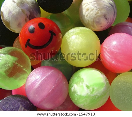 Bouncy balls photographed with natural light. - stock photo
