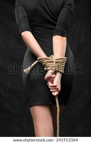Blindfolded hands tied bondage