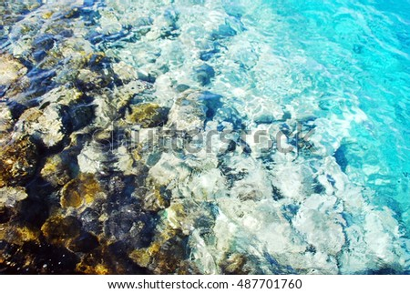 boundless sea surface, only blue nice water and seafloor.