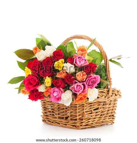 Bouquet colorful roses in wicker basket isolated over white background - stock photo