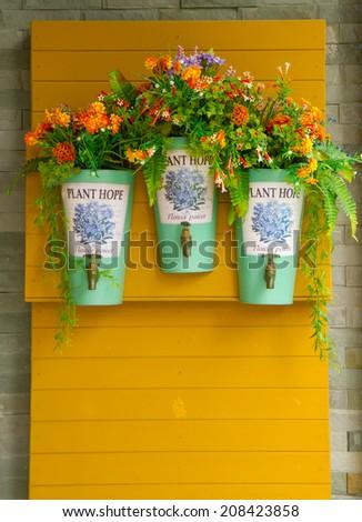 Bouquet flower in flowerpot on wall - stock photo