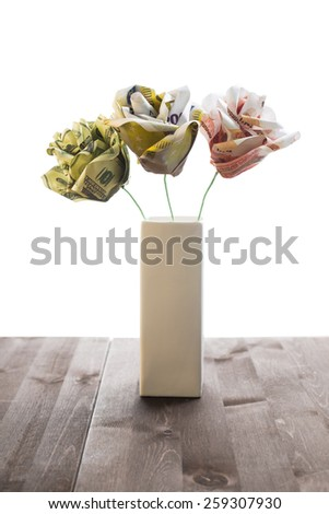 Bouquet flowers of banknotes: 200 euro, 100 dollars and 5000 rubles. Isolated against white backround. - stock photo