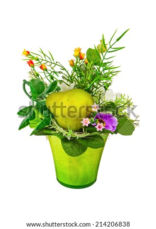 Bouquet from artificial flowers and fruits arrangement centerpiece in vase isolated on white background.