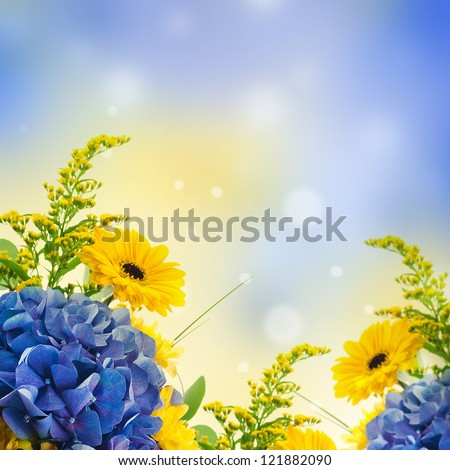 Bouquet from blue hydrangeas and yellow asters, a flower background - stock photo