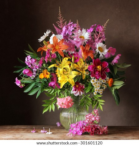Bouquet from cultivated flowers in a jug