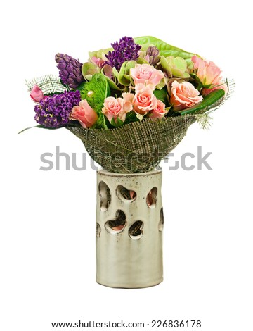 Bouquet from Flowers Arrangement Centerpiece in Vase Isolated on White Background. Closeup. - stock photo