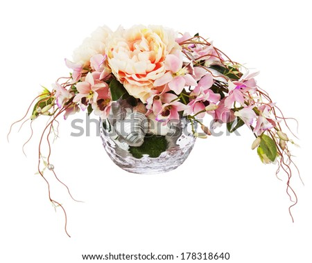 Bouquet from peon flowers and orchids in glass vase isolated on white background. Closeup. - stock photo