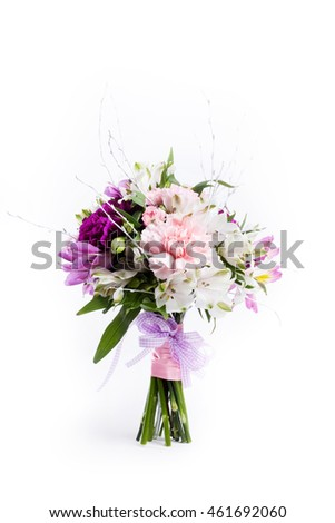 Bouquet from pink and purple gilly flowers on white background from the top