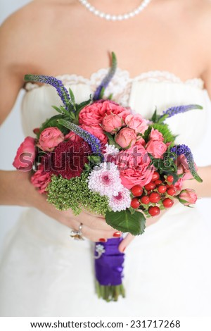 bouquet in hands of the bride - stock photo