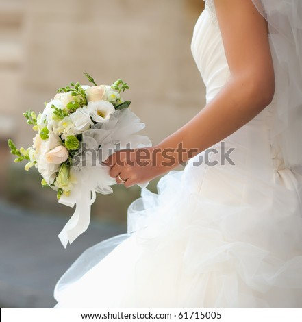 bouquet in the hands of the bride - stock photo