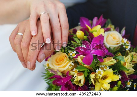 bouquet in the  hands of the bride and groom