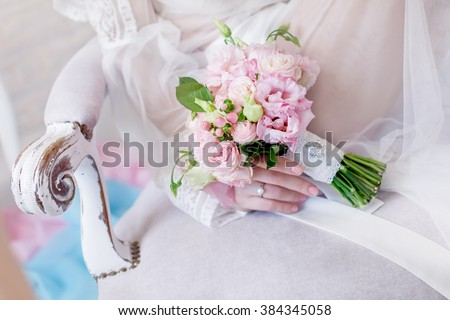 bouquet in the hands of the bride. The bride with a wedding bouquet. The bridal bouquet. wedding bouquet at bride's hands - stock photo