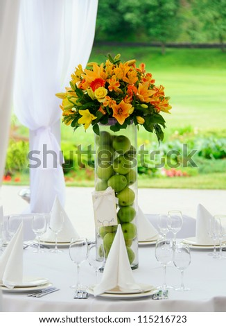Bouquet in vase on decorating wedding table