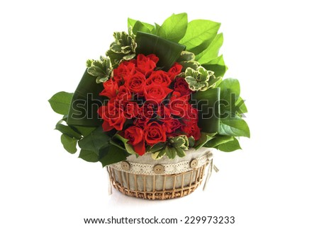 Bouquet in wooden decorative basket isolated over white
