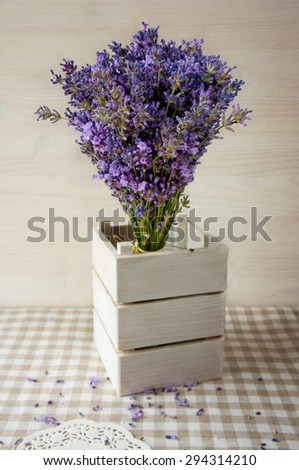 bouquet lavender flowers in a vase on the table - stock photo
