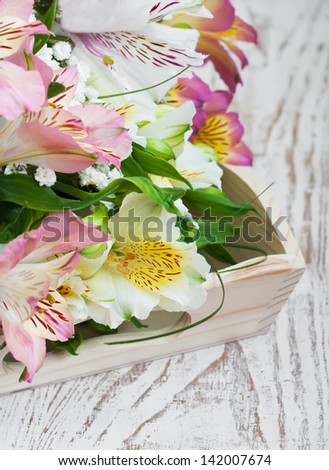 bouquet of a beautiful alstroemeria flowers on wood background