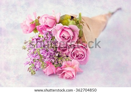 Bouquet of a pink roses on a colorful background .Floral gift for a wedding or birthday. - stock photo