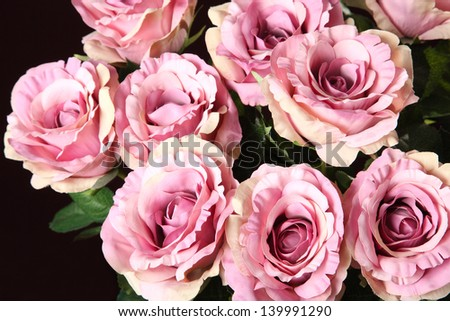 bouquet of artificial roses on a black background - stock photo
