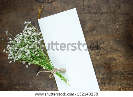 Bouquet of baby's breath (or Gypsophila), and a blank wedding or a party invitation card. - stock photo