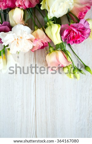 bouquet of beautiful flowers on wooden surface - stock photo