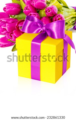 Bouquet of beautiful fresh pink tulips with gift box, spring, easter flowers. Greeting card. Over white background, with copy space, isolated.