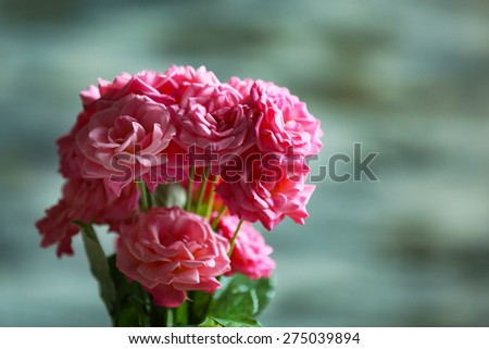 Bouquet of beautiful fresh roses on blurred background