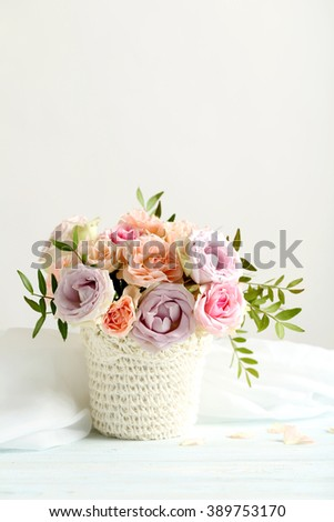 Bouquet of beautiful roses on a blue wooden table - stock photo