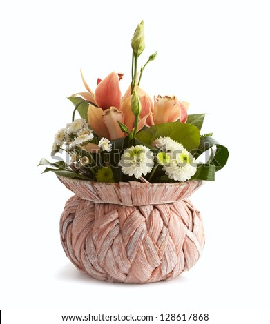 Bouquet of beautiful spring flowers in wicker vase isolated on white background - stock photo